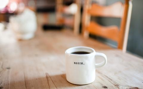 Image of a mug of coffee with the word Begin