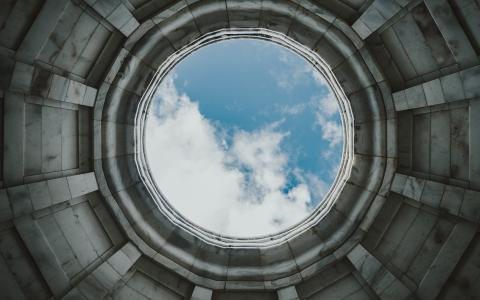 Image of the sky through a circular hole in a roof