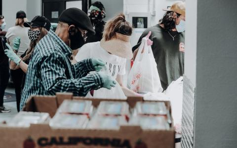 Image of people with food boxes