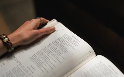 Image of someone holding a bible open
