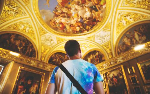 Image of a person looking at a painted ceiling