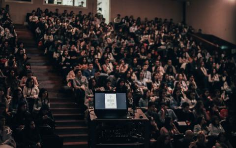 Image of a lecture hall full of people