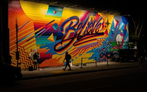 Image of a multicoloured mural saying Believe