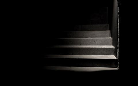 Image of a flight of stairs leading up into darkness